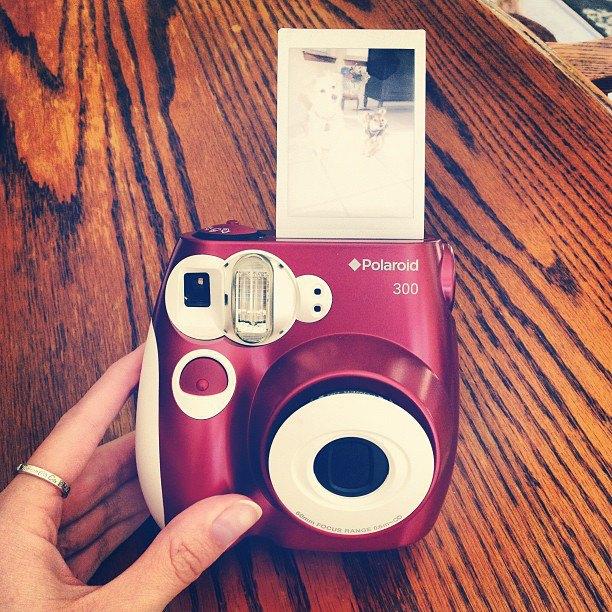 Opinione, macchina fotografica istantanea, pellicola, alto